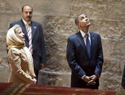 Why???  Was Sec of State Hillary Clinton wearing a head dress today in Cairo???